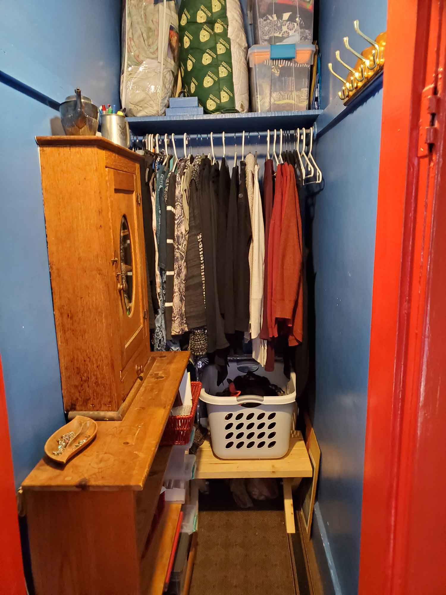 A better organized closet with shelving and cabinet added on the left
