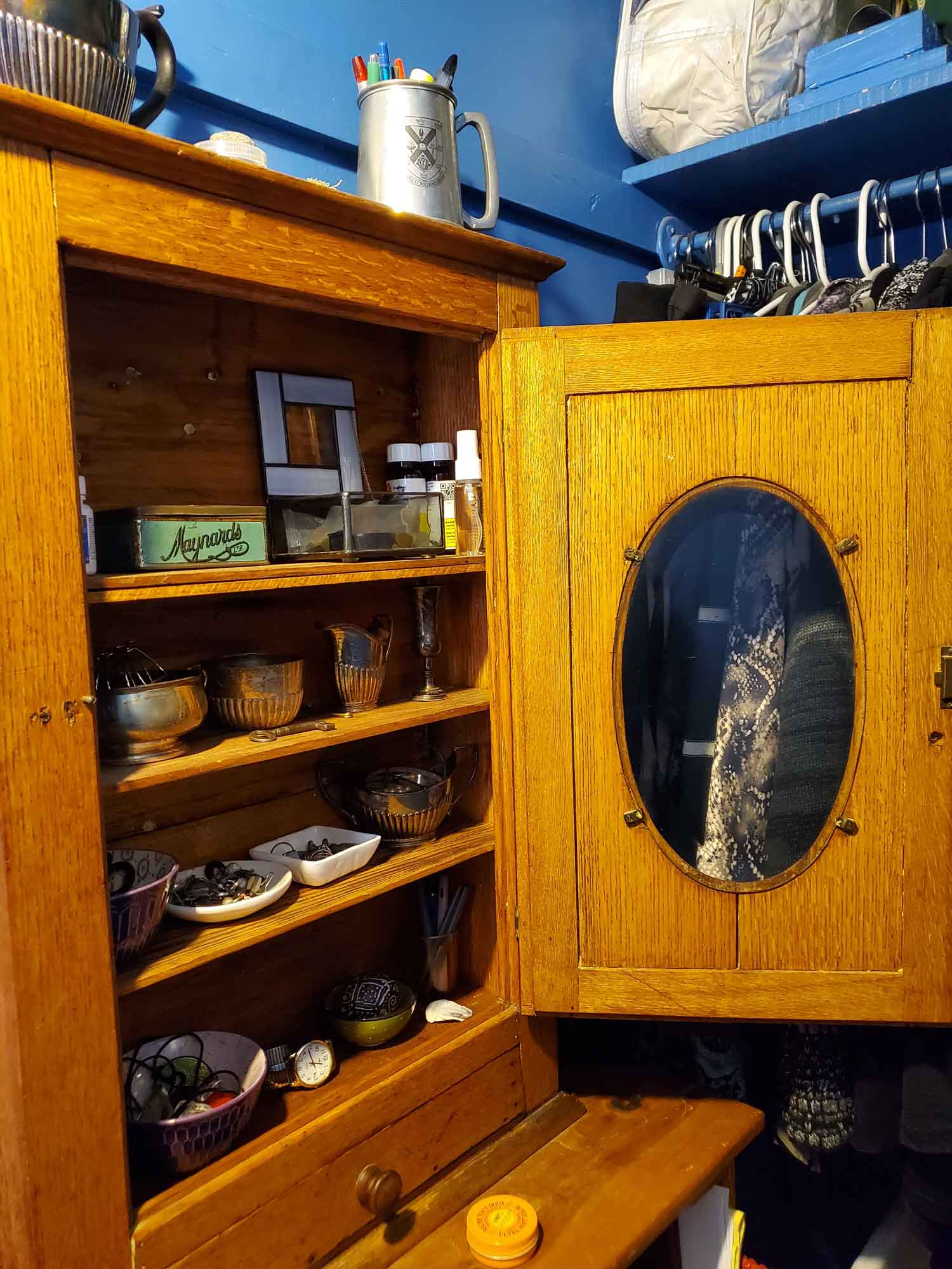 Focus on the inside of the cabinet with items neatly sorted